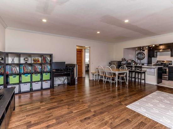Beautifully Renovated 2 Bedroom Open Concept Kitchen, Fantastic For Entertaining. Features Bright Living Room with Bay Windows, High Hats, Alternative Flooring Throughout. Updated Modern Style Kitchen With Center Island And Quartz Countertops. Low Maintenance Includes All Utilities, Taxes And 2 Parking Spots. No Flip Tax, Washer/Dryer Allowed. Close To Long Island Railroad And Highways.