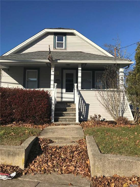 Charming cozy home with front porch,  fenced yard convenient to all. North Merrick Schools.