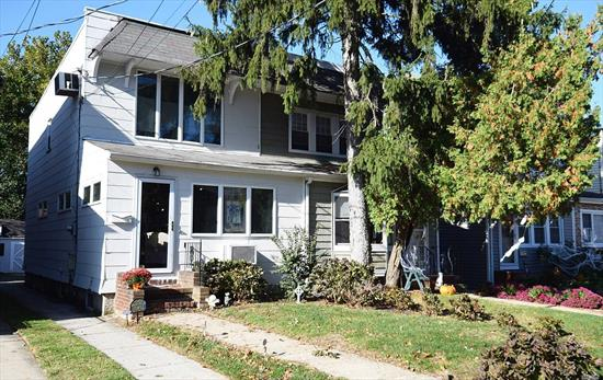 Updated semi on great street. Open and airy decor. Man cave or she shed in back!!