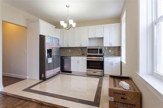 Amazing opportunity to live in your dream home! This brand new renovated 2 family has a total Sf 3039 of living space. This ultra modern house features 9 great size bedrooms, four spa-like full bathroom, a huge gourmet kitchen with custom white cabinets, granite counters, stainless steel appliances that include (dish washer, stove, full size refrigerator, oven). The kitchen opens up into a large living room/dining area with big windows that make this room very bright and open. All central air and heat, and high ceilings. Taxes and HOA's TBD. Seize this great opportunity! This is a commuter's dream location!, only steps away from all transportation to NYC, shopping area and schools.