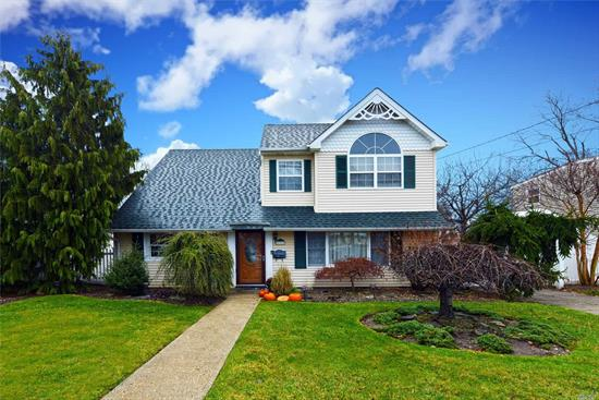 Clean & Meticulous Colonial Located In Massapequa.This Home Features 9 Yr Old Roof, Andersen Windows & Siding, 200 Amp Svc, Cac, Hardwood Floors Upstairs, Eik W/Custom Cabinetry, SS Appls, Granite Cntr Top, Ceramic Tile Backsplach & Floor, Liv Rm, Fdr W/Crown Molding, 2 Full Baths, Den/Office, Lg Master Bedroom W/Custom Closets & Vaulted Ceilings, 2 Additional Bedrooms, Laundry Rm, Shed, Fully Fenced Private Yard W/Brick Patio Perfect For Entertaining, Close To Schools, Shopping, Restaurants & Transportation !