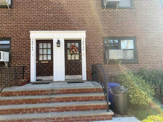 Nestled in a quiet Courtyard in Whitestone, first floor one bedroom apartment. New Kitchen with white cabinets to ceiling, Quartz counter tops, washer/dryer, refrigerator, stove. No Dogs, cat permitted. Close to all.