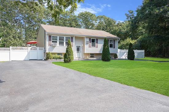 Picture perfect move-in condition Raised Ranch on a 1/3 acre lot! Featuring 4 Bedrooms, 3 full baths with tons of living space. PVC fencing enclosing your private + well landscaped yard with a 20' x 20' back deck off the kitchen. Plenty of parking with two driveways, all COs in place. Outside separate entrance to lower level with room for mom. New SS Appliances + New HW heater + More. Must see, will not last.