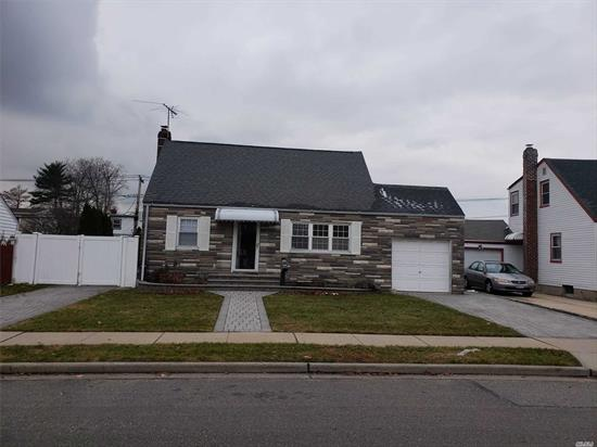 Nicely updated Cape with master bedroom on first floor. Granite kitchen, updated bathrooms. Newly carpeted second floor bedrooms, nicely finished basement with den, office, full updated bath, laundry area. Nice backyard, In Ground Sprinklers, 2 paver driveways, attached garage. Come see this beauty before it's gone. Lot Size: 63 x 101 / School District: #17-Hicksville / Taxes: $6,754.79 / Fuel: Oil / Heat: Hot Water