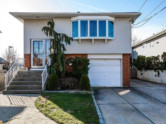 Lynbrook Hi Ranch. 4 Bedrooms 2 Baths. Lynbrook Schools. 10 Year Old Stripped Roof. 9 Year Old Central Air On 2nd Floor. Oak Floors. 2nd Floor Bath Has Double Sink. 2 Zone Sprinklers. 150 AMP Electric. Double Width Driveway-5 Car Parking. Low Taxes For A Hi Ranch. Pending Grievance Filed. Approximately .7 Miles To Lynbrook Train. 1st Floor Handicapped Accessible. Neighbors Have Natural Gas.