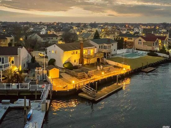Exclusive East Bay Waterfront Hi-Ranch On Oversized Lot On A Cul-De-Sac In Bellmore!!! Largest Model Hi-Ranch With Hardwood Floors, Gas Fireplace, Vaulted Ceilings, Large Living Space, Oversized Property, Floating Dock, Paver Patio, Large Deck, Panoramic Water Views!!