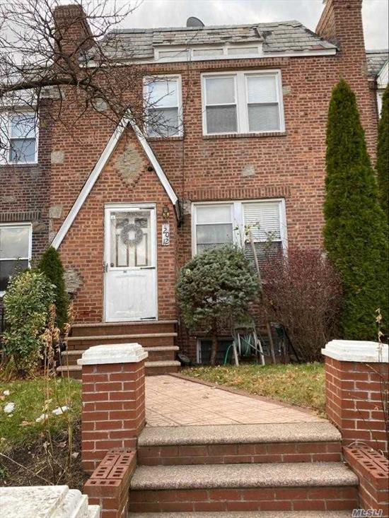 Beautiful and Cozy Three Bedroom, Attached Tudor Style Home, Full Bath On the 2nd Floor. It Features Original Hardwood Flooring, Original Exposed Wood Beams Formal Dining Room, And Finished Basement with Separate Entrance, In The Heart of S. Ozone Park.