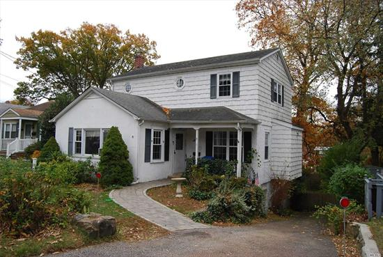 A 4 Bedroom Cape with 3 Baths, Living Room, Eat-in Kitchen, Wood Deck, Private Yard, Shed and Standby Generator.