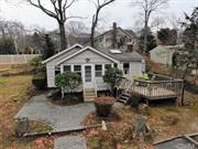 Charming Ranch in Miller Place just a block away from Mount Sinai Harbor. This property features 2 bedrooms, 1.5 baths & an eat-in kitchen with breakfast bar. The brick faced fireplace in the dining area is perfect for the cold winter months. Large wood deck for the summer months and covered porch with an abundance of natural light through wall to wall windows. Part unfinished basement provides extra storage. Located close to dining, & entertainment at both Cedar Beach & Mt Sinai Marina
