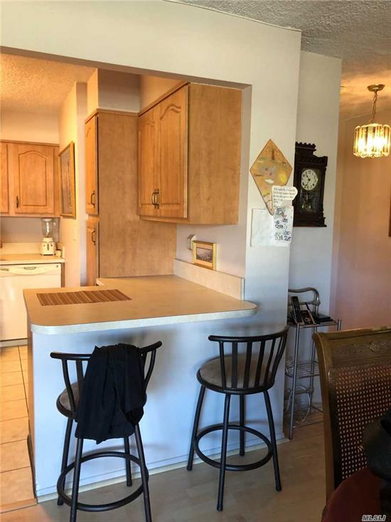 IMMACULATE LARGE ONE BEDROOM WITH RENOVATED KITCHEN AND BATH, LOVELY LAMINATE FLOORS, BUILTIN LINEN CLOSET IN BATH, LARGE CLOSETS AND TERRACE. PRICED TO SELL!! CALL GERI FOR VIEWING 718-614-5169 TO SELL!