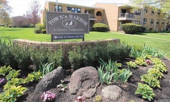 Large Two Bedroom Two Bath Unit on the Second Floor in Town N Harbor. A Spectacular Floor Plan that Features Large Kitchen, Dining Room, Formal Living Room, Master Suite. Sliders Leading to Private Terrace. Beautiful Hardwood Floors, Plenty of Closets Space and Washer and Dryer