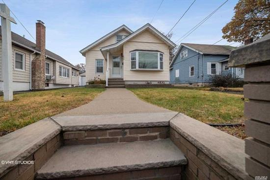 Beautifully Maintained Cape, Features 3 Bedrooms, 2 Full Baths, Living Room w/Fireplace, Dining Room, Updated Kitchen, CAC, Full Basement and Private, Fenced Yard with Pavers. Extended Driveway with Parking for Multiple Vehicles, leading to 1 Car Garage.