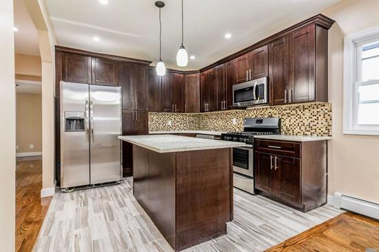 Tastefully Renovated House In Heart Of Queens. Large Custom Kitchens With Granite Counter Tops, Island With Stools to Entertain And Comes With Fully Stainless Steel Appliance Package On Both Floors. And Short Drive tBrand New 4 Full New Baths, Hardwood Floors Throughout The house And Backyard Has Brand New White PVC Fence. Pvt Drwy To Hold Plenty Of Cars. Walk To All Major Bus Stops, Trains Inc LIRR, Schools And House Of Worships. Easy Access To Many Major Highwayso LGA And JFK Airport.