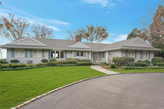 Exceptional Bayfront W High Elevation Situated On Private 1.5 Lush Acres W Panoramic Waterviews Of Peconic Bay Including An Extraordinary White Sandy Bay Beach At All Tides. This Remarkable And Well Maintained Home Boasts A First Floor Master Bedroom Ensuite With Serene Waterviews, Expansive Custom Built Open Floor Plan Kitchen, Spacious & Bright Family Room With Exquisite Built In's And Custom Wood Cross Beams. A Rare North Fork Gem!
