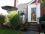 This charming Cape Cod in the heart of Garden City Park is a dream for any commuter, just 4 blocks from Merillon Station and 2 blocks from shopping/dining on Jericho Tpke. Private yard w/ pergola and paved dining area. Gorgeous dark stained floors throughout, updated kitchen, and large finished basement w/ family room and separate utility room. Plenty of room for expansion. Must see!