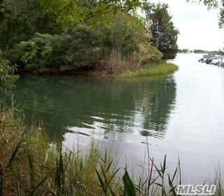Build Your Home on Waterfront on Corey Creek plus Dock allowed w/permit for Boat. 1 Acre of property and BOH approved already. Southold School District. All Survey and building Plans done for proposed Home or build your own home.