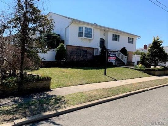 Beautiful 5 Bedroom, Hi Ranch Home. Large Open Floor Plan with Updated Kitchen. Hard Wood Floors & Tiles. Central Alarm System. Outdoor Shed with Electric. Lovely Landscaping with Pavers and Koi Pond , IG Sprinklers. Newer CAC, Oil Burner, Windows. Lager Than It Looks. Accessory Apartment With Permit. Lindenhurst SD