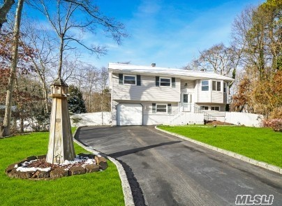 Home in Smithtown Schools, 4 Br, 2 Full Baths, Garage, Open EIK, Hardwood Floors, Gas Heat, Cac-System, Fireplace. Deck off EIK, Best Part Home Sits next to Greenbelt for privacy, Large Private Backyard, Taxes $11k per year, very quiet dead end streets.