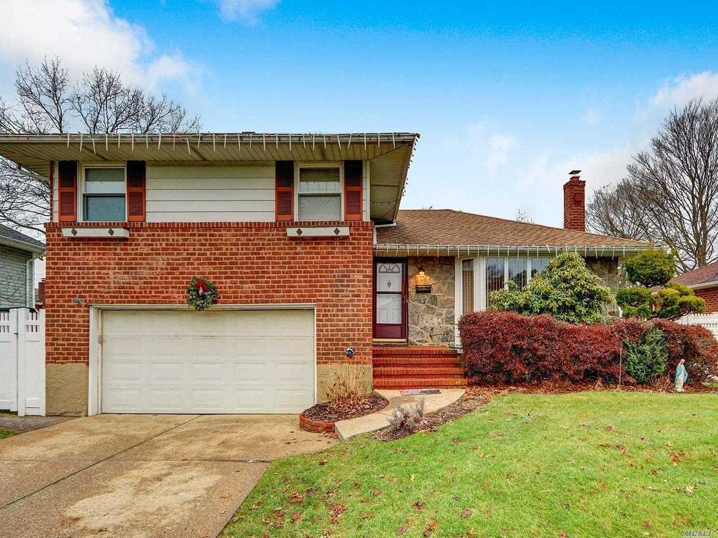 This Lovely Split Level Home Features All Large Rooms, and is Located in Plainedge SD #18!  Eat In Oak Kitchen with Granite Counters with Sliders to Deck and Yard. Andersen Windows, 2 Car Garage, Updated Roof and HW Heater, Gas Heating. **Tax Grievance Has Been Filed For 2019/2020 for 12.5%! (letter attached)** This is a Great Home...Close to RR and Shopping..