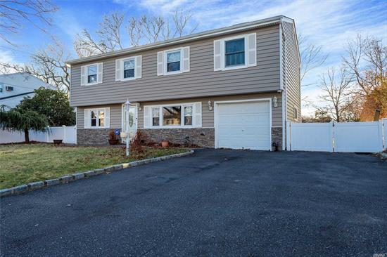 Spacious Expanded Updated Colonial Featuring 3 Large Bedrooms To Include Master Bedroom En-Suite w/Walk-in-Closet & Jacuzzi Tub In Bathroom. Living Room w/Vaulted Ceiling, CAC, New Roof, Fence & Driveway. 1 Car Garage On A Beautiful Piece Of Property.  Great House!!