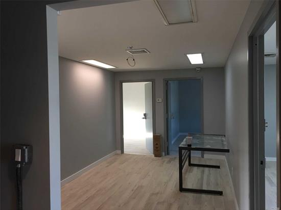 Newly renovated, second floor office. NO elevator, walk-up,  two bathrooms, kitchenette, Central AC, 8 suites, discount parking garage 2 blocks away. very close to LGA