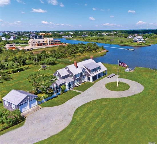 Spectacular waterfront property with gorgeous water views and over 350 feet of water frontage. Wonderful circa 1914 beach house with loads of charm which needs to be raised to the proper elevation OR build your dream home. There's a generous building envelope for substantial house and pool. One of a kind spot.