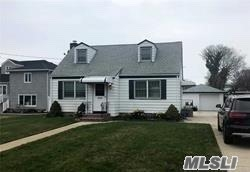 Beautiful Cape in Immaculate Condition Offers Large Living room, Large EIK, 4 Bedrooms, 2 FBaths. Wood Floors thru out. Plenty of Closets/ Storage. Beautiful yard w/rear patio, Full Unfinished basement . Parking