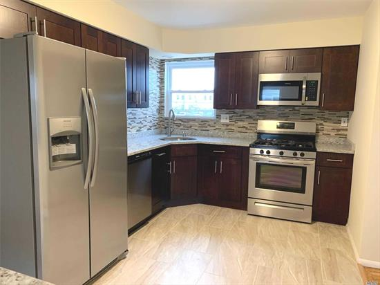 Fully Renovated First Floor Unit. Eat In Kitchen with Stainless Steel Appliances. Spacious Living/Dining Room Area. Updated Full Bath. Large 3 Bedrooms. Washer & Dryer. Refinished Wood Floors Through Out. Driveway Parking for 2 Cars. Close to Transportation and Shops. No Smoking / No Pets.