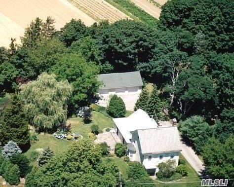 Classic cedar shake farmhouse style home located on Cutchogue's beautiful Main road. A prime corner .75ac lot w lge fenced in yard/garden & det 3CarGge. Flexible 1st flr layout has a cozy den w/wood burning stove, FLR w 2nd wood burning stove, EIK, Office & Din Areas.This home combines the classic charm of period details w newer updates.Perfect for investment, family retreat, or B&B/home office w proper permits.Some TLC needed but much has been done.Vision+Love=unequaled potential.BK UP generator