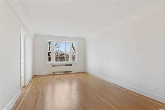 Henley Hall - Jamaica Estates Premier prewar residence! Two bedrooms, gracious dining area, modern kitchen with all new stainless steel appliances. Updated bathroom with separate bathtub and stall shower. Stunning hardwood floors, high ceilings, bright front exposure. Pets with approval, storage available, private garden.