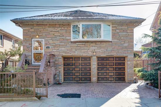 Beautiful large Brick and marble Hi-Ranch. in the Auburndale section! Renovated in 2012. Located Close to Shopping, LIRR and all Transportation!!!! Zoned R3x. Central AC. Hardwood floors thruout . 2 New baths on first floor. Lower level has separate outside entrance and summer Kit. bath.