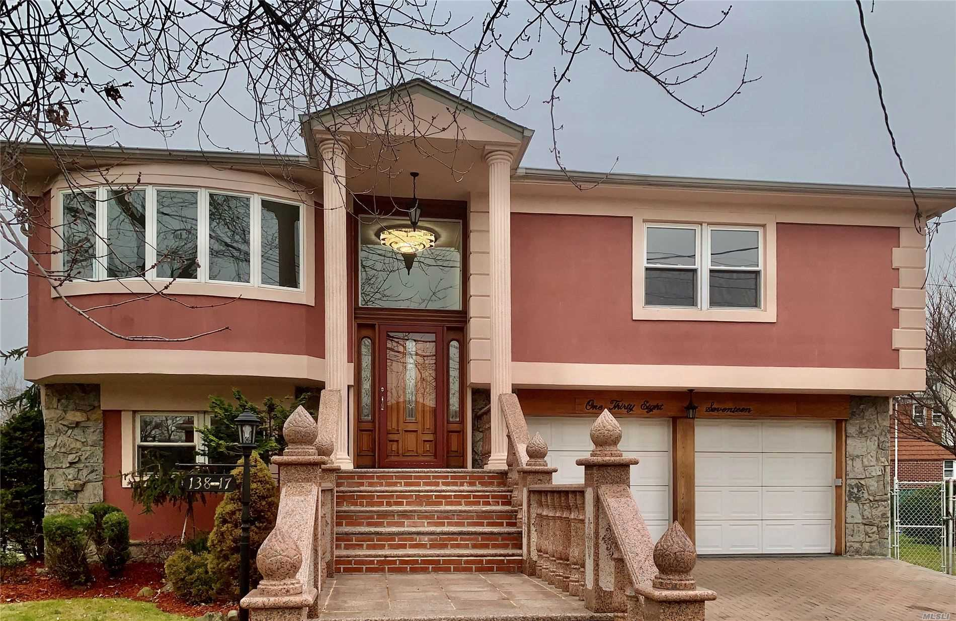 Fantastic 1 Family Located In The Enclave Of Malba.  Totally Renovated. House Boasts 3 Bedrooms + 3 Full Bath. 2 Car Garage, Deck, Patio.