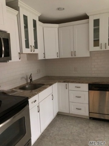 Beautiful spacious one bedroom ground floor apartment with large BR, large new Eat in Kitchen,  newer Stainless Steel appliances. light and bright living room, with hardwood floors throughout. Separate small room for miscellaneous work or can be used as walk in closet. Heat included w/ rent. Near to all! You will love living here!
