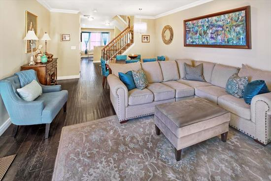 Designer Fanwood style home just three units from Hudson River!!! Fabulous NYC views!!! This beautiful home boasts three bedroom and three and one half baths. Hand distressed wide plank hardwood floors throughout. Custom painted throughout. Crown molding. Wrought iron railings. Granite counters and 42 inch cabinets in gourmet kitchen. California closets. Parking for two cars; one in private garage and one in driveway. Community features two pools with jacuzzis, tot lot, waterfront promenade and free shuttle to ferry. Steps to 158 bus to Port Authority. Close to restaurants and shopping. True Showcase Home!!