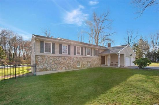 Split Level Expanded Ranch, 3000 sq ft of interior living space, Mstr bd w/ensuite, 3 bds, 2 full baths, EIK w/ceramic flooring, Living room & Lrg Dining Area w/vaulted ceiling, sunroom with heated parquet flooring, fireplace & wetbar.