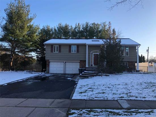 Beautiful Hi Ranch close to parks, shopping and highway. Home has 4 Bedrooms and 3 full bathrooms. Wood Floors throughout, central air, in-the -ground pool, fenced yard. Smithtown SD.