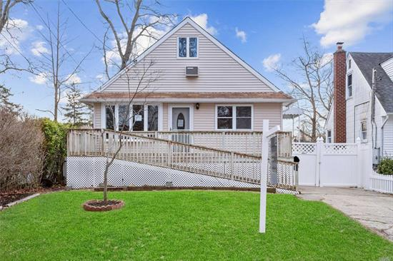 Come See This Adorable Cape-Style Home In The Beautiful Copiague! Featuring An Eat In Kitchen, A Living Room With Wood Burning Stove Perfect For Entertaining, And A Full Basement For Storage! Conveniently Located Close To Transportation, Pearsall Park,  Ketcham Creek, And All Your Shopping And Dining Needs! Don't Miss Out On This One!