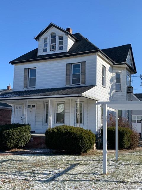 Bright Sunny Great Starter Home Looking For That Special Buyer To Provide Some TLC. 3 Story Colonial On Large Corner Lot. 2 Driveways, Detached Garage, Fully Tiled Basement. Quiet Neighborhood But Close To All : 15 Minutes From JFK, One Block From Public Transportation.