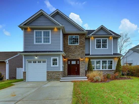 Stop and take a look at this Immaculate New Construction in the desired location of Merrick. This stunning colonial has 5 large bedrooms & 3.5 baths. Modern EIK w/ SS appliaces, Island, Granite counters. Coffered Ceiling in living room. High-hats & hardwood floors through out. Upstairs MBR has vanity bath & walk-in closet. Full finished basement is a plus. Office, attic, this house has it all!! Huge fenced backyard. Attached garage w/private driveway. Must see!!