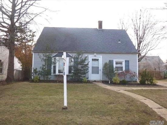 Levitt cape with updated, windows, roof, siding, kitchen, bath and flooring on first floor. Close to all ones needs. With a little work, make this the perfect home for you live in and love.