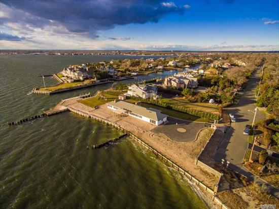 Bayberry point Bayfront and canal, deep water cut in boat slip, very private location, 330' & 106' on c anal, sunsets and sunrises, fire island and bridge view, privacy gate