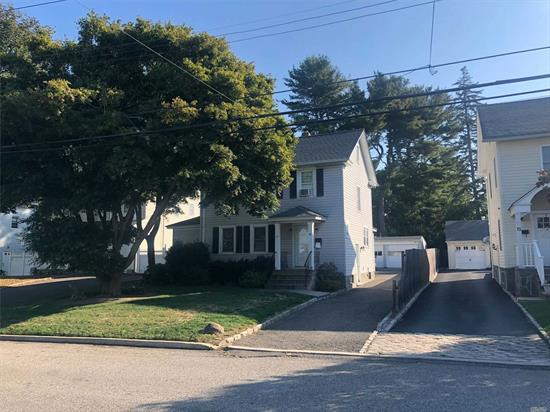 Amazing 2 family Colonial. Desirable Mid-block location. Both apartments have extra storage space. Attic/Basement. Downstairs apartment has been totally renovated. Separate rentable 2 Car Garage, Lovely flat property, mature trees, large driveway, plenty of parking.