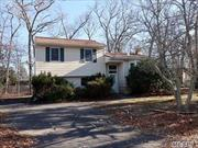 Calling all Handymen/Handywomen/Investors! Opportunity is knocking in this 4 BR, 2 bath Split level situated on 0.4 Acre Corner Lot in Setauket Gardens/Three Village SD. This home requires TLC and is being sold AS IS. Hardwood Floors in LR/DR/Hallways & Bedrooms. Anderson Windows, Roof & Siding 10 years young, 5 year new oil burner, updated 200 amp electric and one zone CAC. Bring your imagination, tool box, and paintbrush!