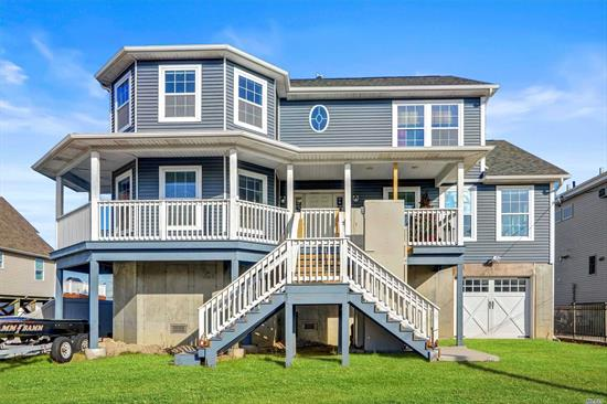 Put your personalized touches on this 4 Years New, 3000 sq. ft 5 Bed/3.5 Bath, Waterfront home with 60' of new Bulkhead. 14' Elevated, this home was built with no expense spared. Let your groceries be taken upstairs via elevator, plenty of room for your vehicles in the 1500 sq. ft garage. 2 Master bedrooms. Unbelievable Closets, and Extra storage in the Granny Attic, enjoy the 180* views from your third story stargazing deck. 40 Amp Subpanel on Dock, Outdoor Shower Don't let this one slip by!