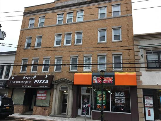 Two Bedroom Apartment With Open Living Room, Dining Area and Kitchen. Apartment Building is Directly Across From LIRR Train Station.