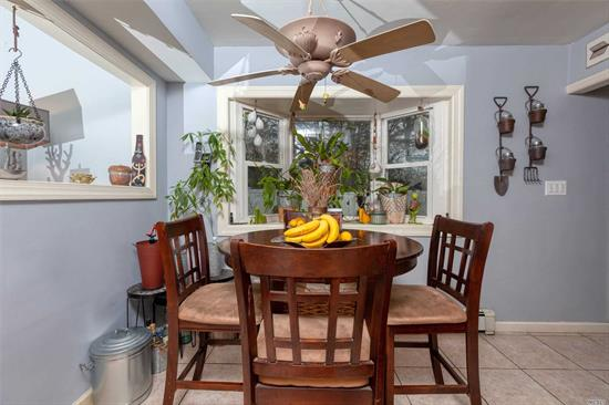 Beautiful center hall colonial. Middle Country S.D. Many updates: 7-year young architectural roof and vinyl siding, updated granite kitchen with tumble stone back splash, New Peerless boiler under a year old.Updated windows and bathrooms. 6 Years Young. IG Pool, Koi pond, New PVC fenced backyard, Great for entertaining..Too much to list, A Must See. Make This Your New Happy Home.