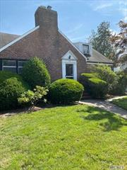 Beautiful Corner House in Old Woodmere. Brick 4 Bedrooms, 2.5 Bathrooms Colonial, with Attached 2 Car Garage. Great Location.
