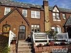 Spacious Tudor Townhouse. Sunken living room, with fireplace. New Kitchen, 3 large bed rooms. Finished basement. Wood floors. Walk to Auburndale LIRR Station. Bus # Q12, 13, 28. Q m3 to Manhattan. P.S. 107.,  I.S. 25.,  Bayside High School.