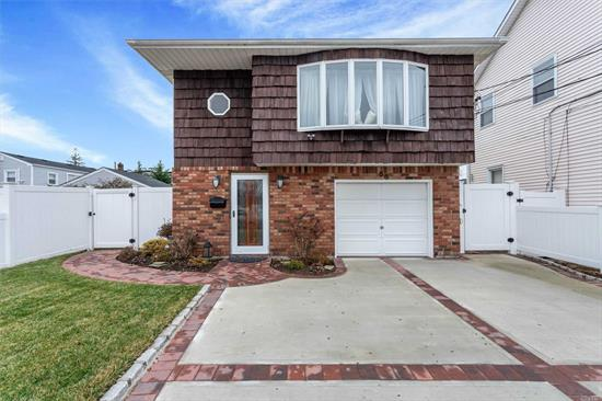 Beautiful completely redone legal 2 family w/owner occupied permit. Open floor plan. Granite all new stainless app, eik, dining rm/Living rm, hardwood floors. Separate ground floor entrance apartment . 2 bedrooms, with its own dish washer.Wood floors throughout mirrored closet sliding doors, 5 ceiling fans.All new brick pavers patio, and walk way.A new cement 2 car drive way. Completely fenced in yard. A Must See. No Flood insurance required.