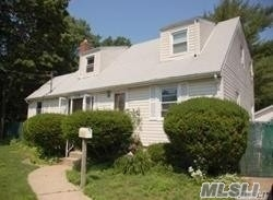This 6 bedroom, 2 full bath expanded Cape is situated at the end of a Dead-End Street. It does require some TLC.